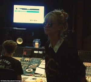 Dancing in the studio: Delta can't help herself and dances away to one of her songs as it is recorded