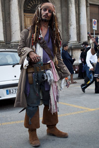 A Jack Sparrow impersonator who is clearly in character.