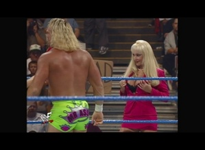 Debra distracts Billy Gunn