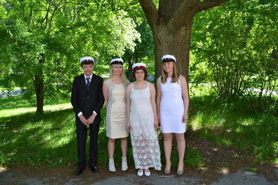This is how me and my classmates looked when we graduated from high school June 2013, I'm the shortest one of us, but out of the girls I have the longest dress