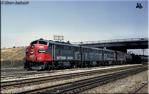 Roger was driving this freight train out of the yards.