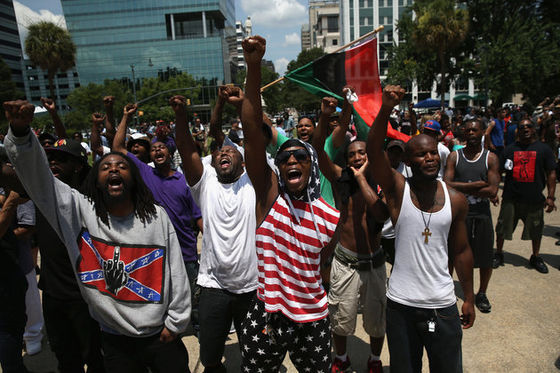 Black Educators for Justice rally against the KKK for the removal of the Confederate flag from the South Carolina statehouse. (source: Huffington Post)