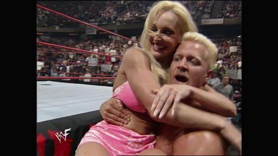 Jeff Jarrett carries Debra away after her evil act!