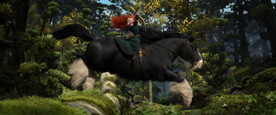The scene of Merida doing archery in the forest.