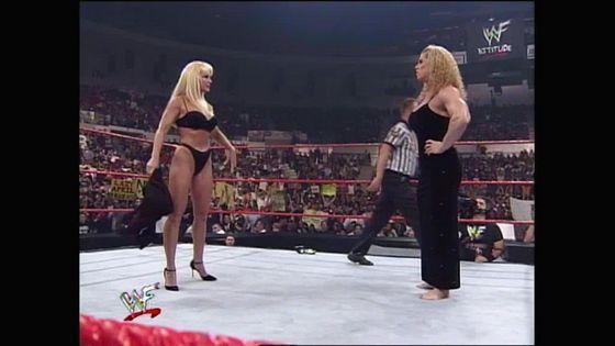 Debra strips to forfeit the match!