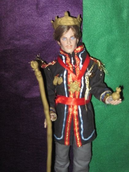 an example of one of my doll customizations: the King of Arendelle with my dad's eye color