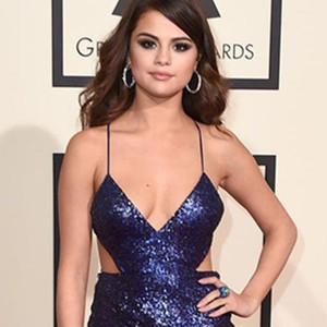 86fa7bb705 Plunging and side slit sexy silver celebrity prom dress. 2 Selena Gomez in  a casual red satin dress when out ...