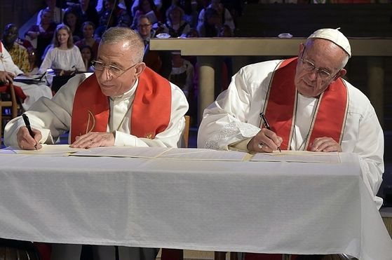 Pope Francis & The President Of The Lutheran World Federation Signing A Joint Declaration