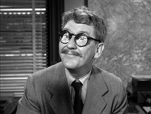 "Henry Bemis of ""Time Enough at Last"", an early episode of The Twilight Zone."