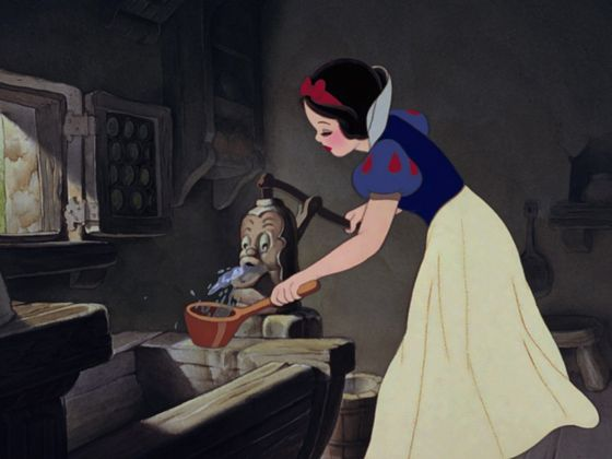 Snow White kindly offers a drink to an elderly lady