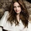 Kristen Stewart as Bella Swan/Cullen