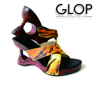 This is an innovation in fashion, high-heeled shoes made of wood and covered with ornaments car