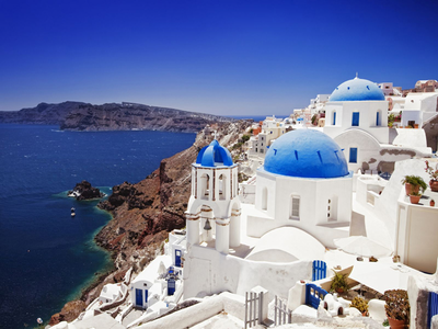 I 'm really fine with the place I live in. But if I had to choose somewhere else, then Santorini isla