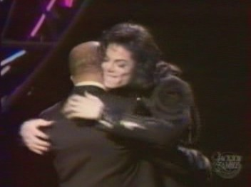 Michael hugging longtime friend and mentor, Berry Gordy, after presenting him an award at The Jackson