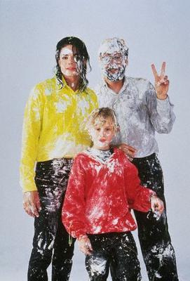 Michael with Macaulay Culkin and John Landis after a cake fight