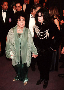 "Michael escorting good friend, Dame Elizabeth Taylor to her ""65th"" birthday party back in 1997"