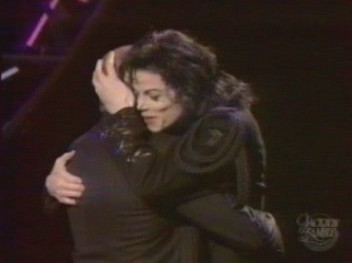 Michael hugging Berry Gordy at the Jackson Family Honors awards ceremony back in 1994
