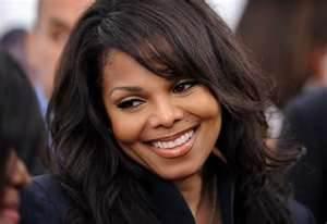 Janet Jackson she's one of few old school R&B singers just like Michael