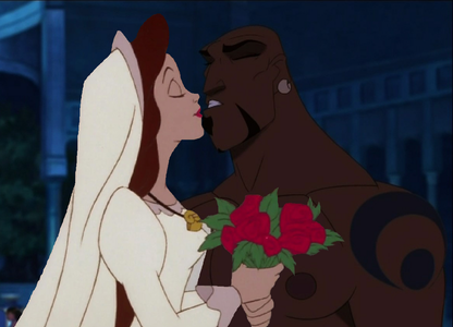 I am useless at making kisses but here u go! It's Vanessa from Little Mermaid and Kale from Sinbad