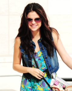 mine i want a pic of sel with long curly hair!!