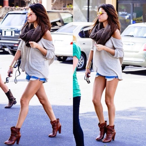 I want a picture of Selena wearing thigh high boots
