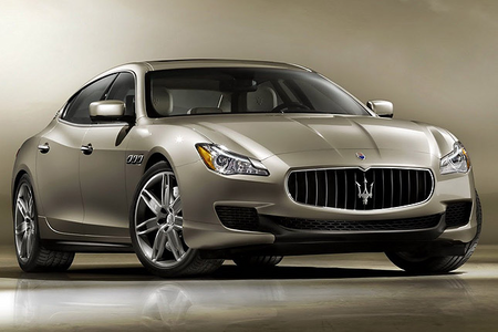 She'd drive a Maserati Quattroporte. (Hah, Italian is such a tuneful language... Quattroporte means F