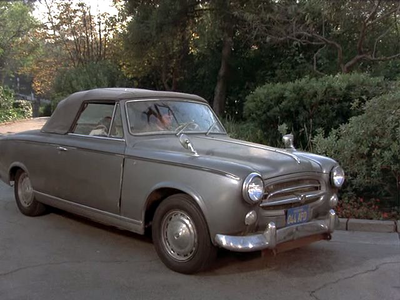 She'd drive a '60 peugeot 403 Cabriolet, like Columbo. :) What would Blinkie Pie have?