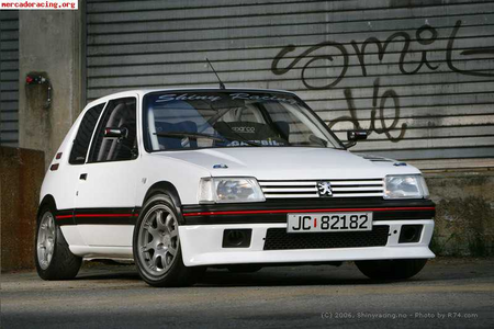 She'd have a '87 peugeot 205 GTI. What would Surprise have?