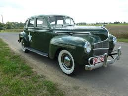 Derpy would drive a 1940 Plymouth P11. What would upinde wa mvua Dash have?