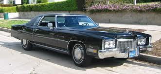Hmm. Good question. I suppose she wouldn't mind having a 1969 Cadillac 쿠페, 쿠 페 De Ville. I saw a blue o