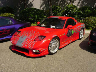 Spitfire would drive a 1999 Mazda RX-7. What would Spike have?
