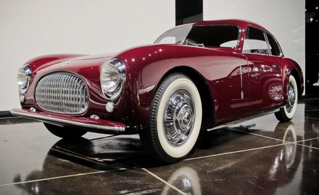 Octavia would drive a 1947 Cisitalia 202 Pininfarina. What would Viny Scratch have?