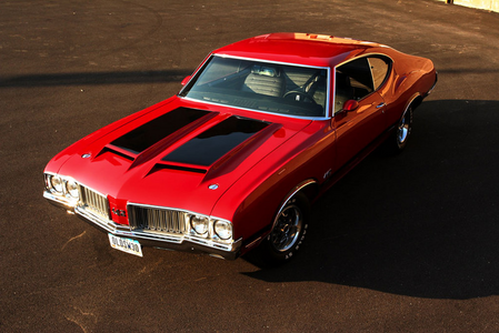 Gilda would drive a 1970 Oldsmobile 442. What would Midnight Strike have?