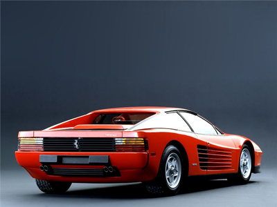 デイジー would drive a 1983 Ferrari Testarossa. What would June Bud have?