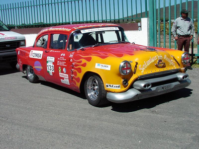 Colgate would drive an Oldsmobile Racing car. What would Roseluck have?