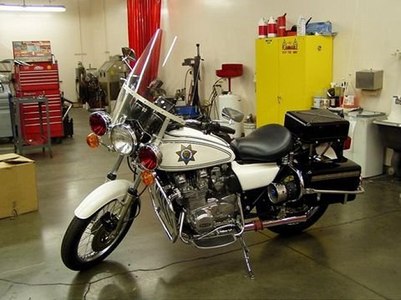Discord would ride a 1975 Kawasaki KZ900 Police bike. What would reyna Chrysalis have?