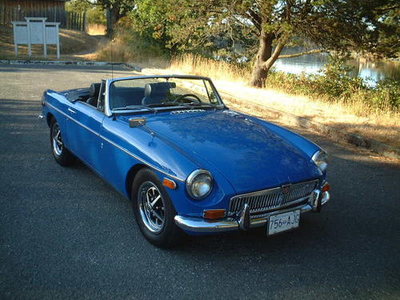Gilda would drive a 1970 MG MGB. What would Gustav have?
