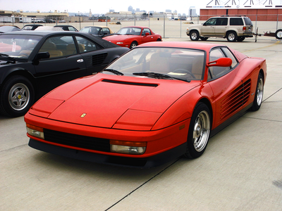 Lyra would drive a Ferrari Testarossa. what would Bon Bon have?