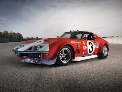 That's also easy. I'd have a 1968 Chevrolet Corvette race car. What would Nicole Oliver have?