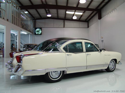 Colgate would drive a 1954 Kaiser Manhattan. What would Bon Bon have?