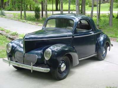 Fluttershy would have a 1940 Willys Americar. What would Trixie have?