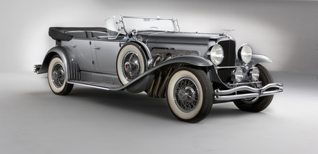 Trenderhoof would drive a 1929 Duesenberg Model J. What would Discord drive?