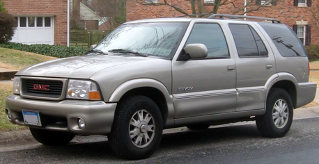 Gilda drives a 2000 GMC Envoy. What does Gustav have?