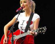 Holding A guitar, gitaa ! I Want Taylor Wearing Pants !
