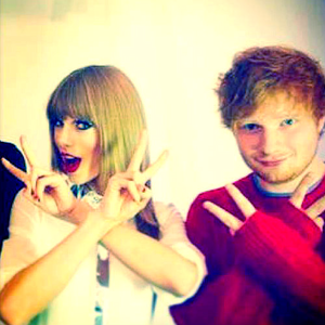 tay doing a funny pose with ed i want a pic of taylor flipping her hair