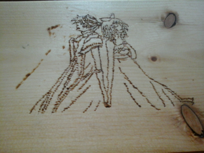 I've done 3 woodburnings, and here's the first one! It's Rin and Len Kagamine from Synchronicity.