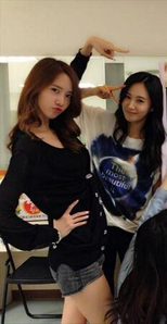 Here I Command a picture of SEOFANY wearing गुलाबी outfit