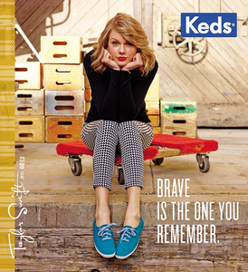 Taylor with blue shoes.:}