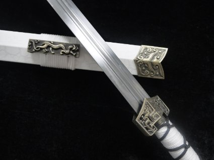(Grip and case of the the Yang sword made from pure ivory with black leather, and they Grip and case