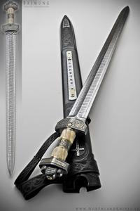 (( Herryk's Sword, just make the hilt dhahabu metal and Dark brown wood & Leather, like the two below! )